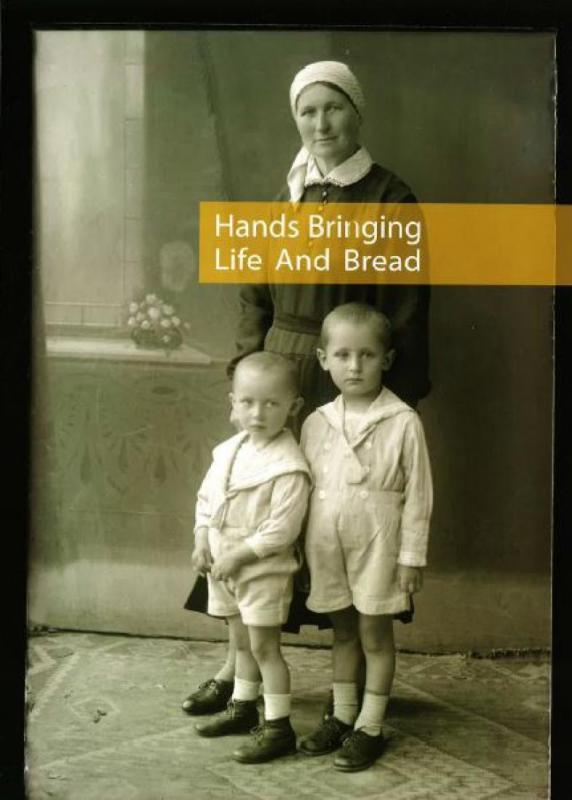 Hands bringing life and bread
